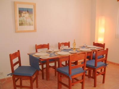The dining area is also situated at the front of the property. The large extendable dining table