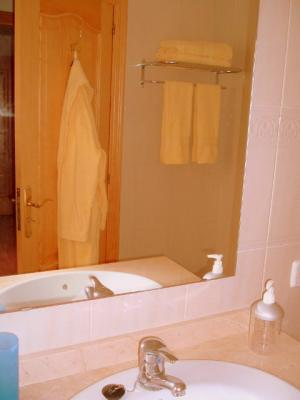 The bathroom features WC, bidet, bath with shower above.